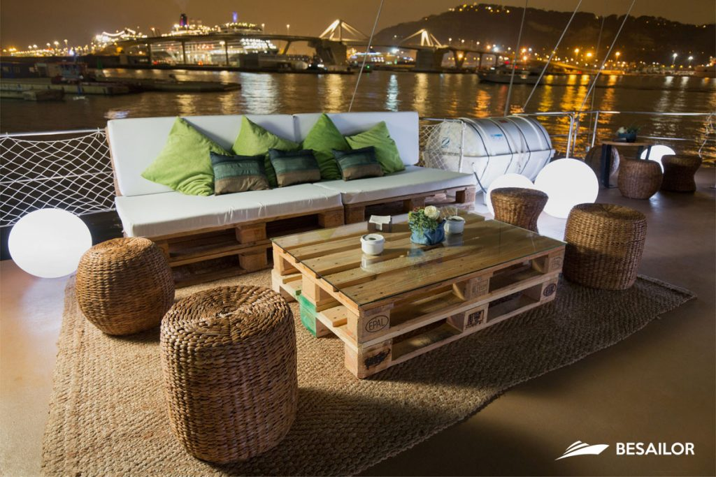 Table, sofa and round lights on Boat's Deck