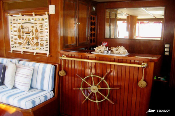 Bar with rudder and sofa in living room of Classic Super Yacht