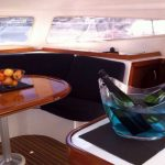 Cava and fruit in Outremer 42 Catamaran