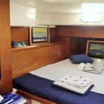 Double bed, wardrobe and paintings in Cabin of Pajot Lavezzi