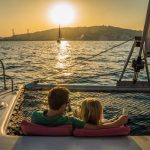 Two people resting on Solarium with net in Catamaran