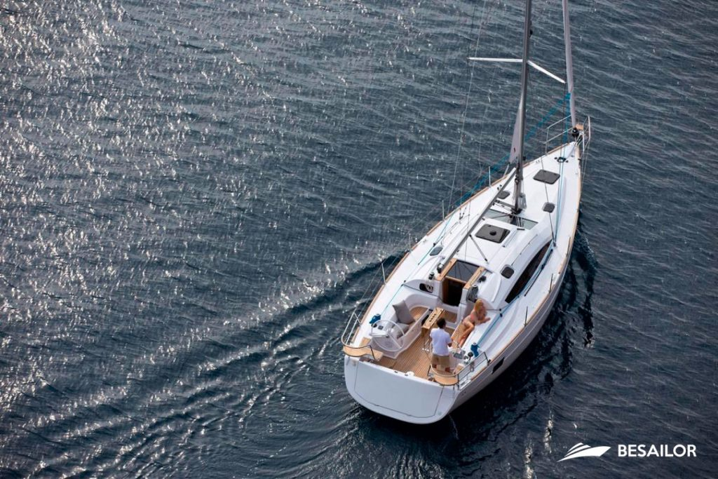 Elan Impression 40 with two people on its deck