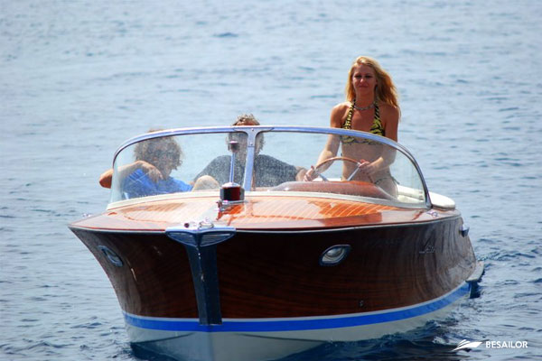 Sailing boat with family in the sea